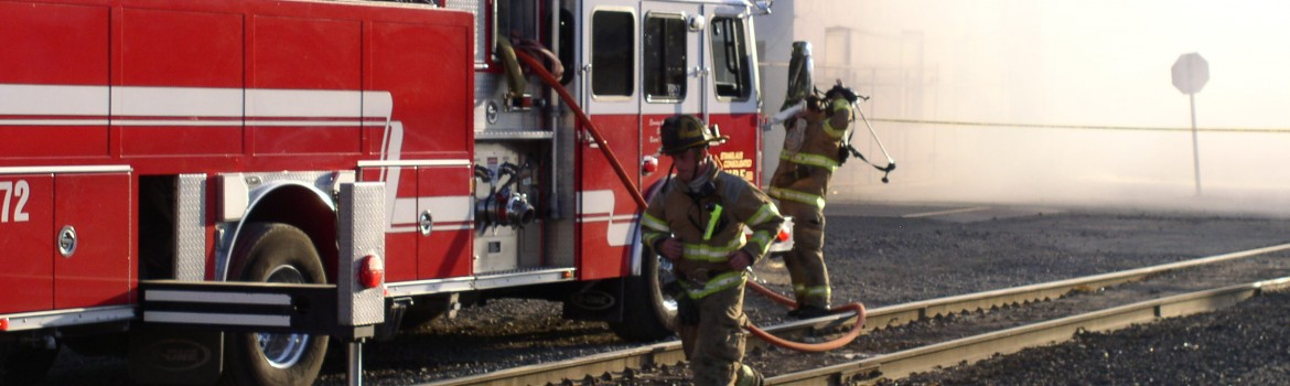 Firefighters by train tracks