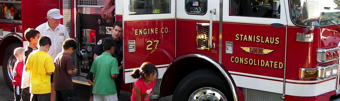 Children looking inside fire engine